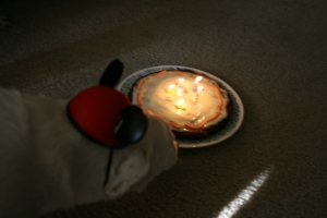 Remus investigates his cake. Maybe the candles were a little off-putting...